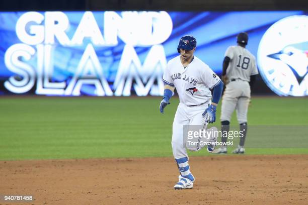 Justin Smoak of the Toronto Blue Jays is circles the bases after hitting a grand slam home run in the eighth inning during MLB game action against...