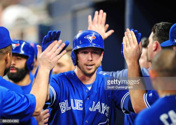 Justin Smoak of the Toronto Blue Jays is congratulated by teammates after hitting a tworun fourth inning home run against the Atlanta Braves at...