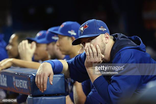 Justin Smoak of the Toronto Blue Jays looks on from the dugout in the ninth inning against the Kansas City Royals during game four of the American...