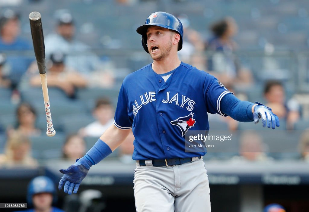 Justin Smoak #14 of the Toronto Blue Jays reacts after striking out in the ninth inning against the New York Yankees at Yankee Stadium on August 18, 2018 in the Bronx borough of New York City.