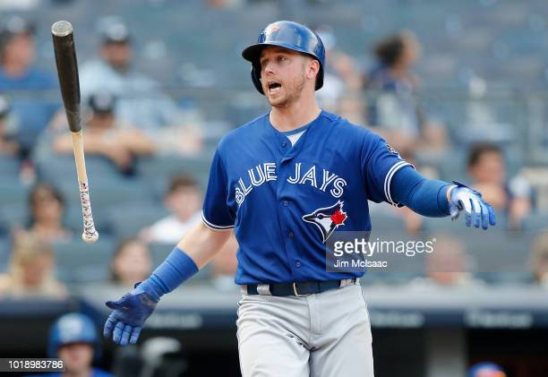 Justin Smoak of the Toronto Blue Jays reacts after striking out in the ninth inning against the New York Yankees at Yankee Stadium on August 18, 2018...