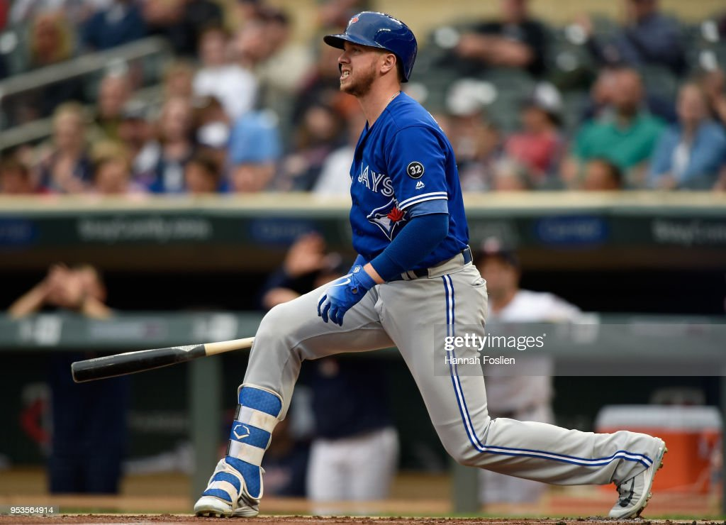 Justin Smoak #14 of the Toronto Blue Jays reacts to striking out against the Minnesota Twins during the first inning of the game on May 1, 2018 at Target Field in Minneapolis, Minnesota.