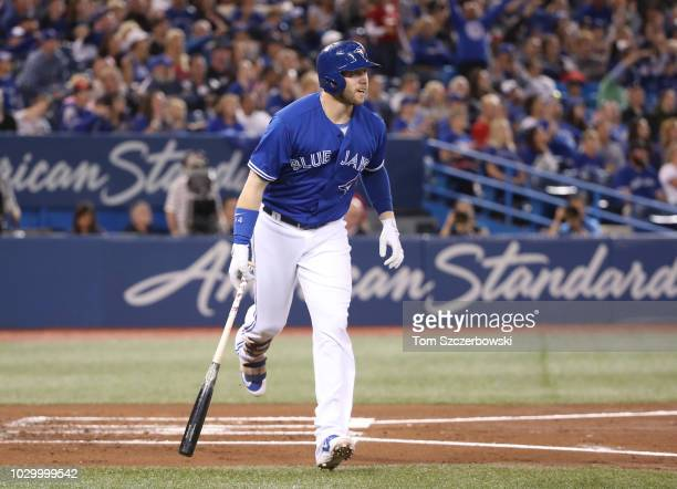 Justin Smoak of the Toronto Blue Jays rounds the bases on his tworun home run in the first inning during MLB game action against the Cleveland...