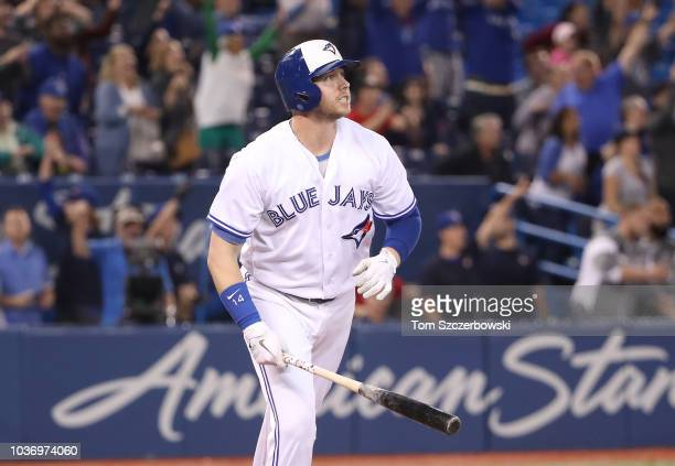 Justin Smoak of the Toronto Blue Jays watches as he hits a gamewinning solo home run in the ninth inning during MLB game action against the Tampa Bay...