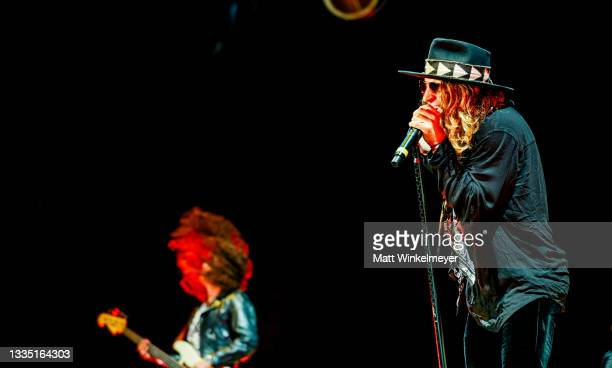 Justin Smolian and Marc Labelle of Dirty Honey performs at The Forum on August 19, 2021 in Inglewood, California.