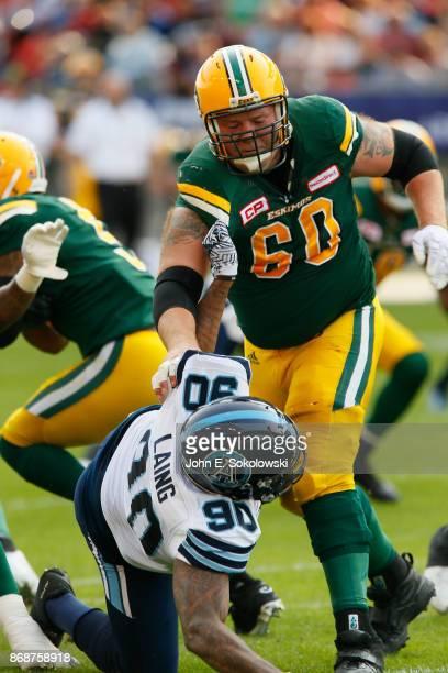 Justin Sorensen of the Edmonton Eskimos blocks Cleyon Laing of the Toronto Argonauts during a game at BMO field on September 16 2017 in Toronto...