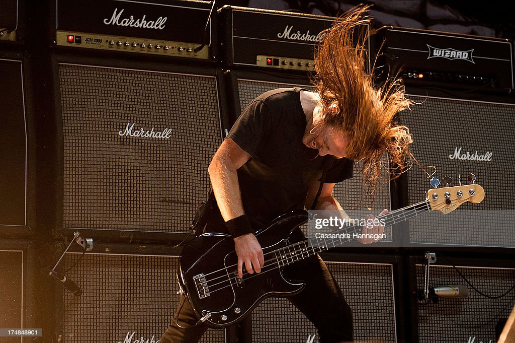 Justin Street of Airbourne performs for fans on day 3 of the 2013 Splendour In The Grass Festival on July 28, 2013 in Byron Bay, Australia.