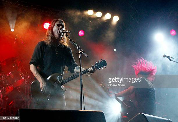 Justin Sullivan and Ceri Monger of New Model Army perform at Day 2 of the Sonisphere Festival at Knebworth Park on July 5 2014 in Knebworth England