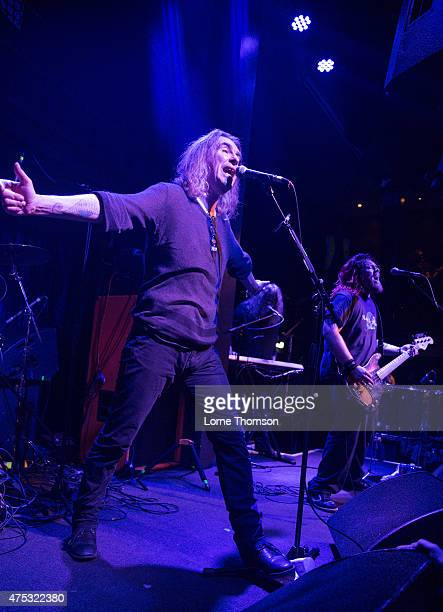 Justin Sullivan and Ceri Monger of New Model Army perform at the Jazz Cafe on May 30 2015 in London United Kingdom