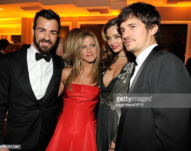 Justin Theroux Jennifer Aniston Miranda Kerr and Orlando Bloom attend the 2013 Vanity Fair Oscar Party hosted by Graydon Carter at Sunset Tower on...