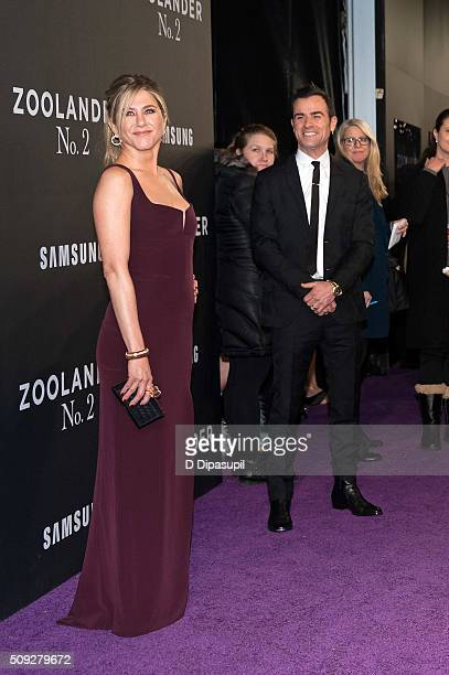 Justin Theroux looks on as Jennifer Aniston poses on the carpet during the 'Zoolander 2' world premiere at Alice Tully Hall on February 9 2016 in New...