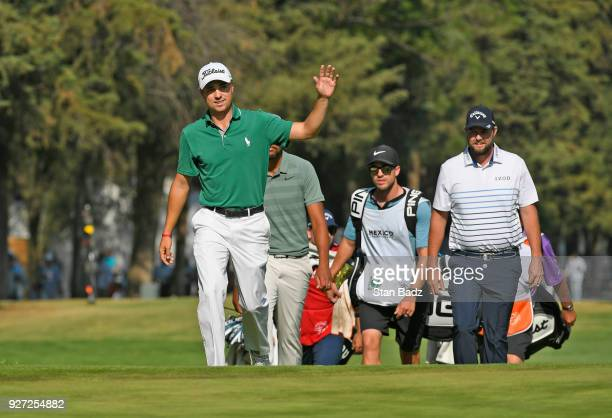 Justin Thomas acknowledges fans after making an eagle from the 18th fairway during the final round of the World Golf Championships-Mexico...