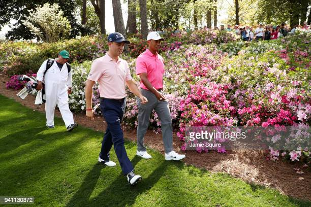 Justin Thomas amd Tiger Woods of the United States walk on the seventh hole during a practice round prior to the start of the 2018 Masters Tournament...