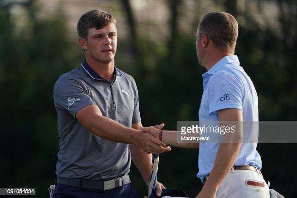 Justin Thomas and Bryson DeChambeau of the United States shake hands after the final round of the Sentry Tournament of Champions at the Plantation...