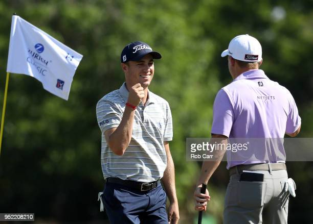 Justin Thomas and Bud Cauley react to a putt on the 14th green during the second round of the Zurich Classic at TPC Louisiana on April 27 2018 in...