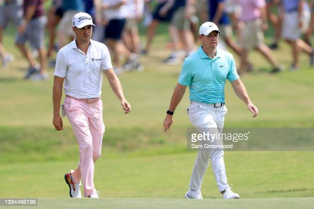 Justin Thomas and Rory McIlroy of Ireland walk down the first hole during the final round of the World Golf Championship-FedEx St Jude Invitational...