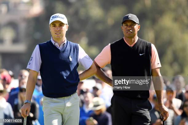 Justin Thomas and Tiger Woods of the United States stand on the third green during the first round of the Genesis Invitational on February 13 2020 in...