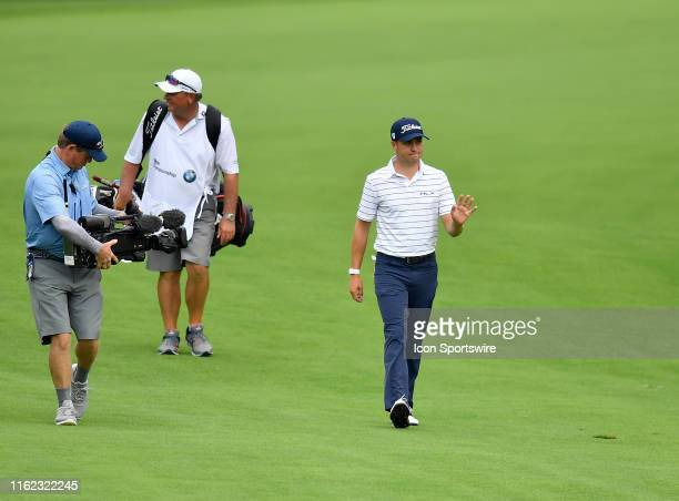 Justin Thomas celebrates after his eagle shot on the 16th hole during the third round of the BMW Championship at Medinah Country Club No 3 on August...