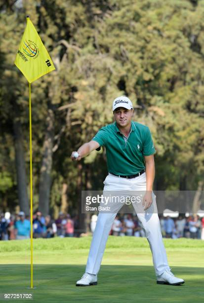 Justin Thomas celebrates after making an eagle from the 18th fairway during the final round of the World Golf Championships-Mexico Championship at...