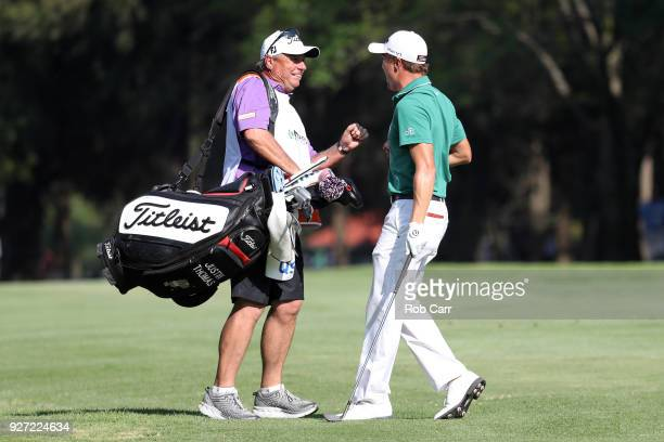 Justin Thomas celebrates with his caddie after making an eagle from the 18th fairway during the final round of World Golf ChampionshipsMexico...