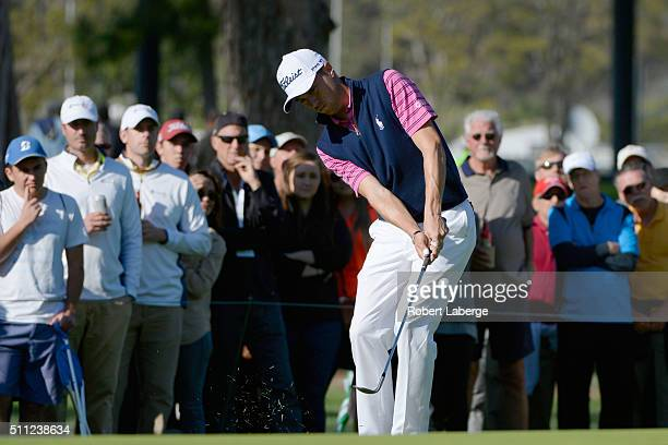 Justin Thomas chips on the 12th hole during round one of the Northern Trust Open at Riviera Country Club on February 18 2016 in Pacific Palisades...