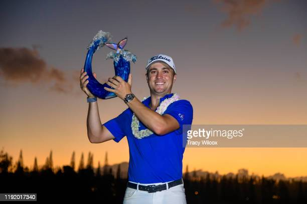 Justin Thomas holds the trophy after winning a three-hole playoff during the final round of the Sentry Tournament of Champions on the Plantation...