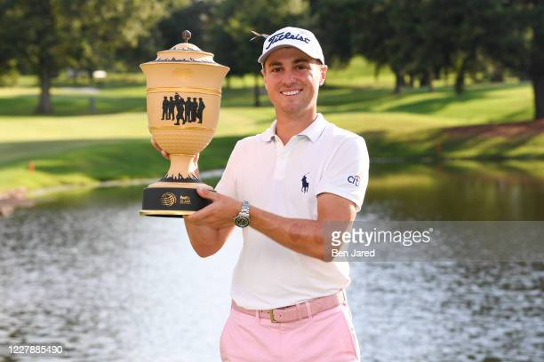 Justin Thomas holds the trophy on the ninth green during the final round of the World Golf Championships-FedEx St. Jude Invitational at TPC Southwind...