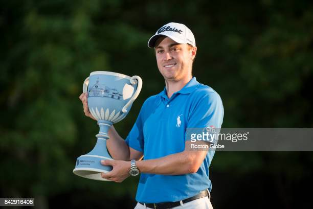 Justin Thomas holds up his trophy after winning the Dell Technologies Championship at the TPC Boston in Norton MA on Sep 4 2017