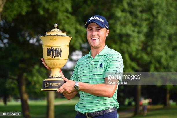 Justin Thomas laughs while holding the Gary Player Cup trophy following his four stroke victory in the final round of the World Golf...