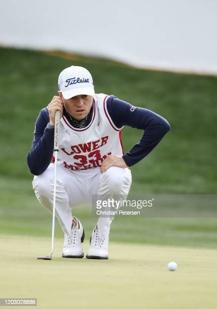 Justin Thomas lines up his put on the 16th hole while wearing a replica high school jersey of former NBA player Kobe Bryant during the first round of...