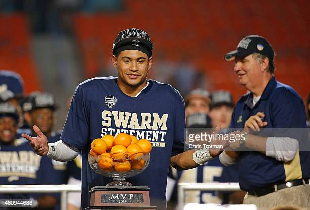 Justin Thomas of the Georgia Tech Yellow Jackets stands with the MVP trophy after the Capital One Orange Bowl game against the Mississippi State...