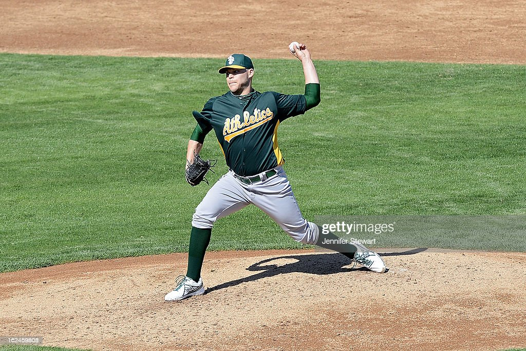 Justin Thomas #45 of the Oakland Athletics pitches in the spring training game against the Milwaukee Brewers at Maryvale Baseball Park on February 23, 2013 in Phoenix, Arizona.