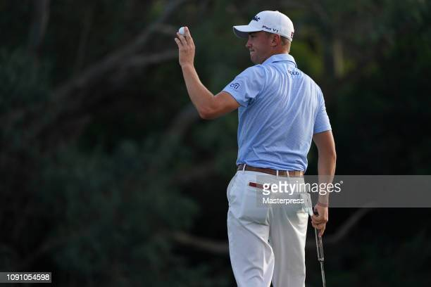 Justin Thomas of the United States acknowledges on the 18th green during the final round of the Sentry Tournament of Champions at the Plantation...