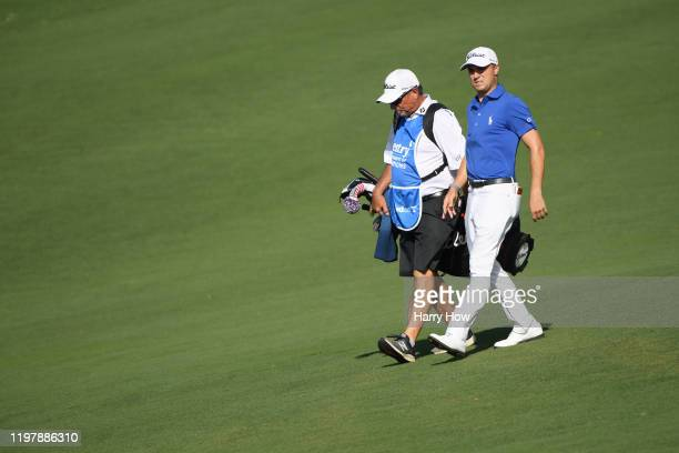 Justin Thomas of the United States and caddie Jimmy Johnson walk on the 12th hole during the final round of the Sentry Tournament Of Champions at the...