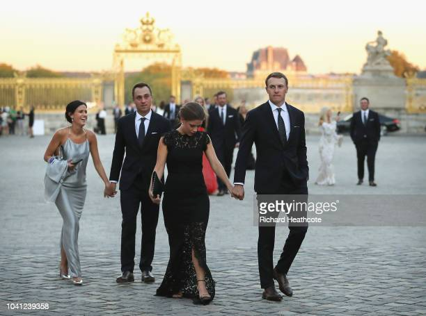 Justin Thomas of the United States and girlfriend Jillian Wisniewski arrive at the Palace of Versailles with Jordan Spieth of the United States and...
