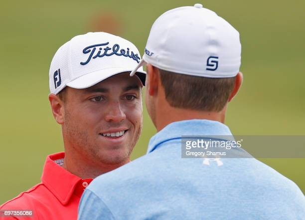 Justin Thomas of the United States and Jordan Spieth of the United States meet on the range during the final round of the 2017 US Open at Erin Hills...