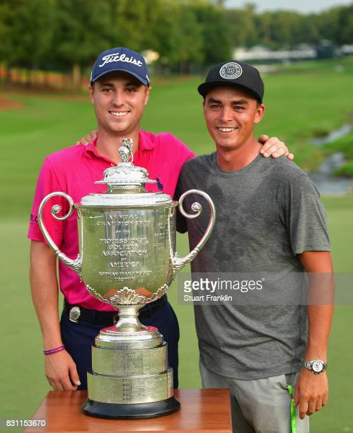 Justin Thomas of the United States and Rickie Fowler of the United States pose with the Wanamaker Trophy after winning the 2017 PGA Championship...