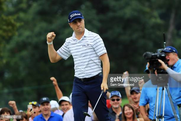 Justin Thomas of the United States celebrates after chipping in on the 14th hole during the third round of the BMW Championship at Medinah Country...
