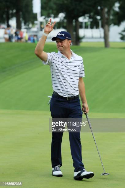 Justin Thomas of the United States celebrates after his eagle on the 16th hole during the third round of the BMW Championship at Medinah Country Club...