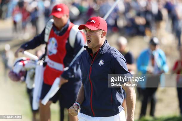 Justin Thomas of the United States celebrates chipping in on the 12th during singles matches of the 2018 Ryder Cup at Le Golf National on September...