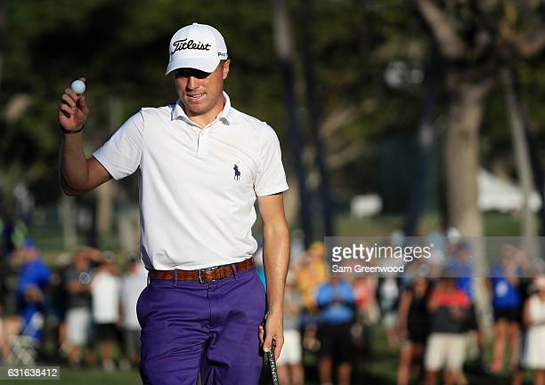 Justin Thomas of the United States celebrates his eagle putt on the 18th green during the second round of the Sony Open In Hawaii at Waialae Country...