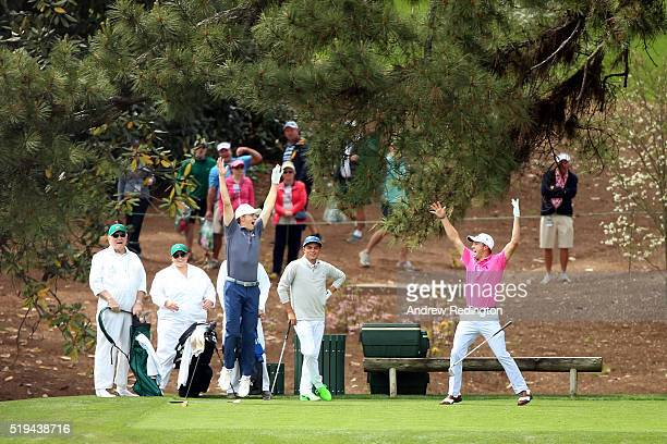 Justin Thomas of the United States celebrates his hole in one with Jordan Spieth of the United States and Rickie Fowler of the United States on the...