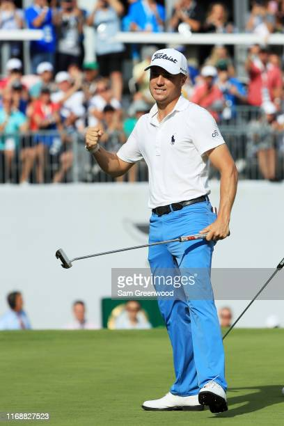 Justin Thomas of the United States celebrates on the 18th green after winning during the final round of the BMW Championship at Medinah Country Club...
