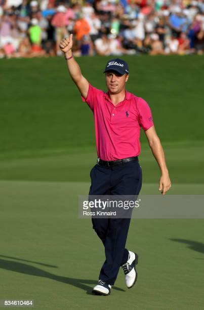 Justin Thomas of the United States celebrates on the 18th green during the final round the 2017 PGA Championship at Quail Hollow Club on August 13...