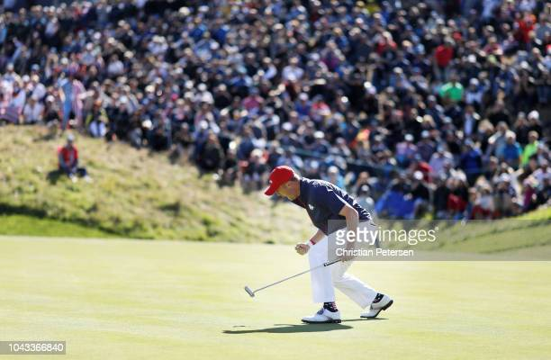 Justin Thomas of the United States celebrates on the green during singles matches of the 2018 Ryder Cup at Le Golf National on September 30 2018 in...