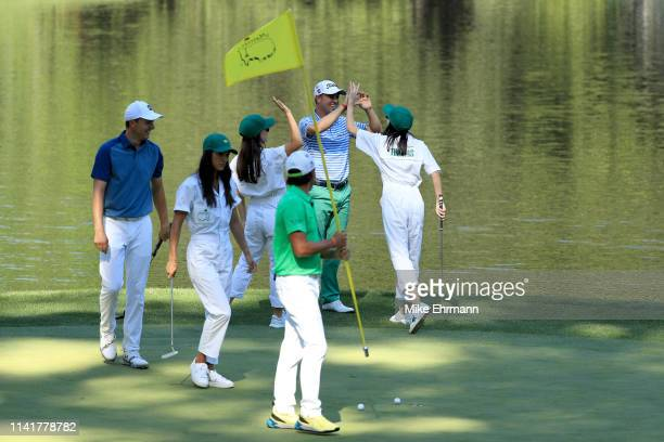 Justin Thomas of the United States celebrates with girlfriend Jillian Wisniewski during the Par 3 Contest prior to the Masters at Augusta National...