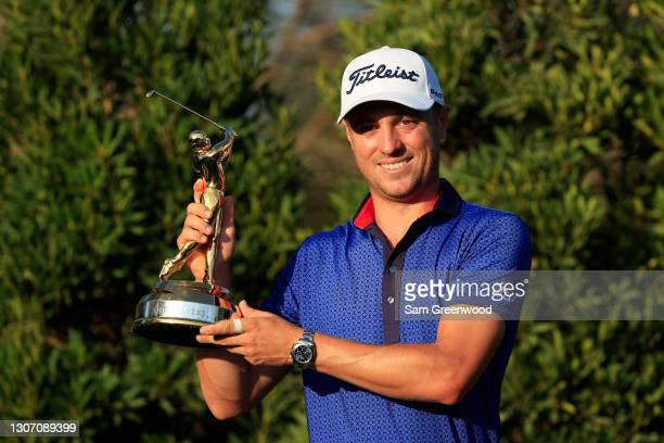 Justin Thomas of the United States celebrates with the trophy after winning during the final round of THE PLAYERS Championship on THE PLAYERS Stadium...