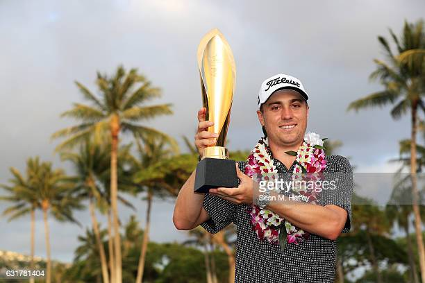 Justin Thomas of the United States celebrates with the trophy after winning the Sony Open In Hawaii at Waialae Country Club on January 15 2017 in...