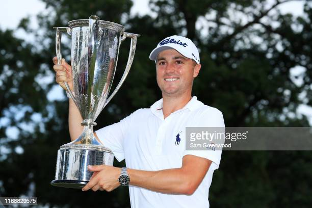 Justin Thomas of the United States celebrates with the winner's trophy after the final round of the BMW Championship at Medinah Country Club No. 3 on...