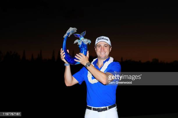 Justin Thomas of the United States celebrates with the winner's trophy after the final round of the Sentry Tournament Of Champions at the Kapalua...